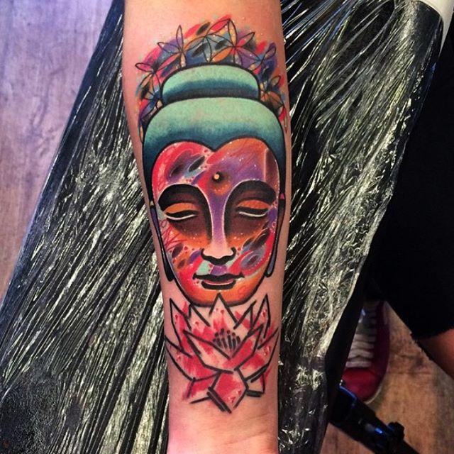 space textured Buddha face tattoo