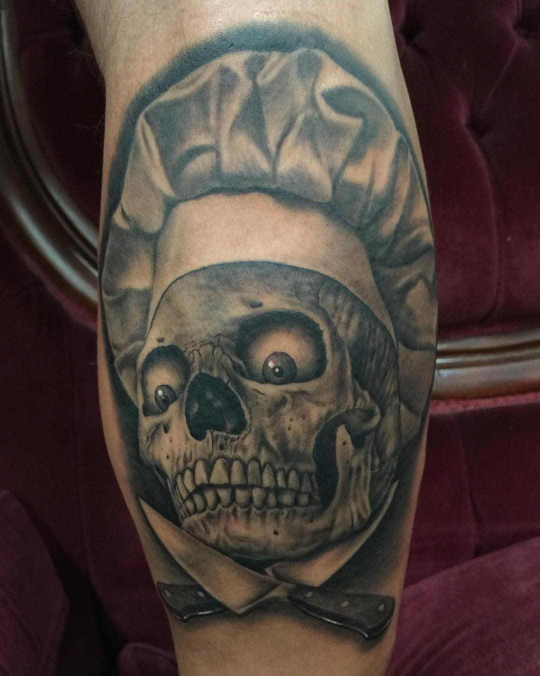 the skull in chef's hat with crazy eyes and two knives