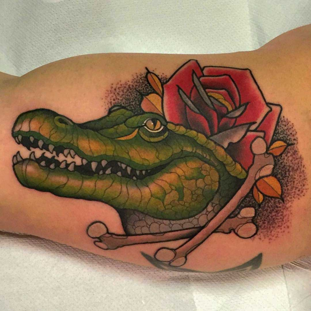 Crocodile tattoo on bicep