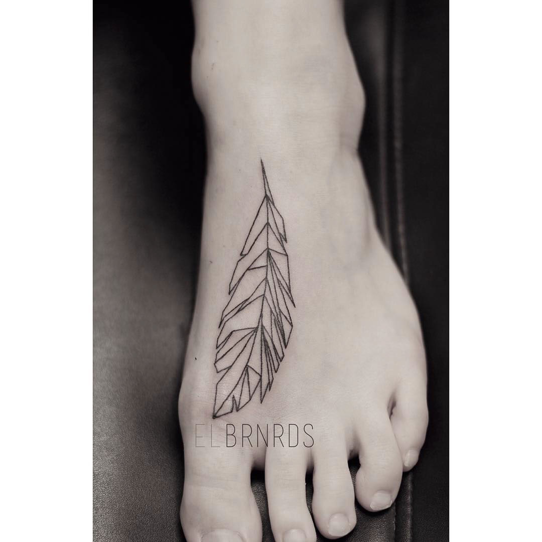 geometrical feather tattoo on foot