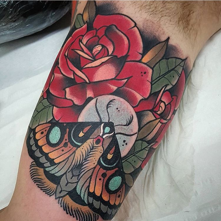 moth butterfly and red roses  tattoo on bicep