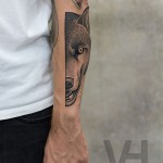 Half of Wolf Head Tattoo on Arm
