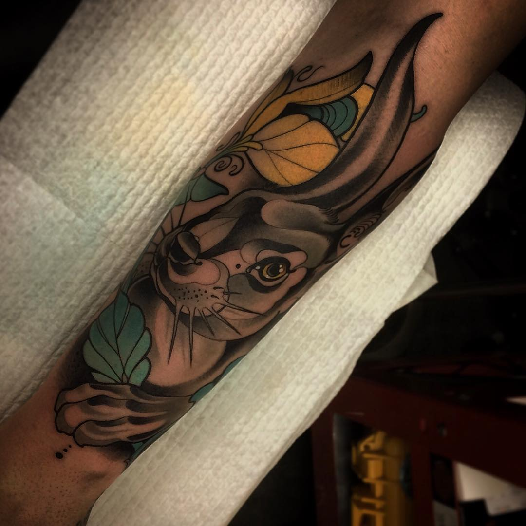 neo-traditional hare tattoo on arm