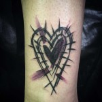 brush drawn heart tattoo on arm