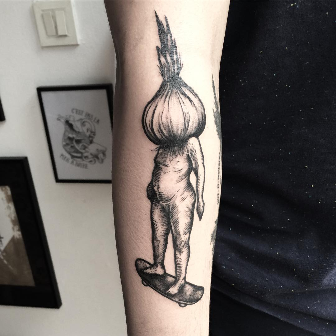 an arm tattoo of a man with an onion insted of the head