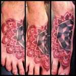 black and red dotwork tattoo on foot