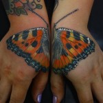 Matching Butterfly Tattoo on Hands
