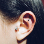 small ear tattoo note