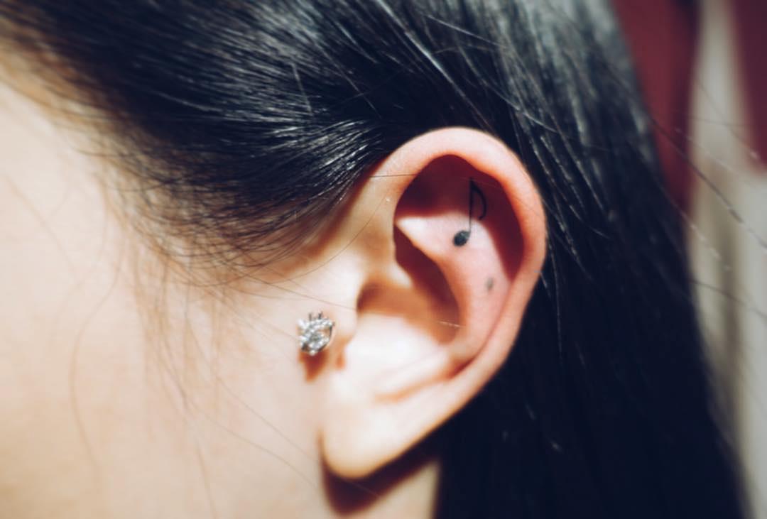 small ear tattoo note