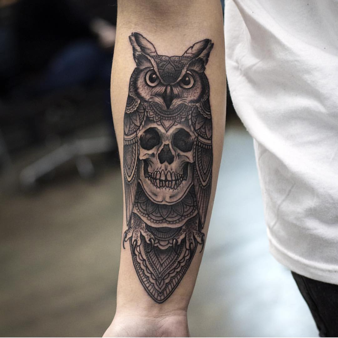 the owl tattoo with a skuul instead of its body