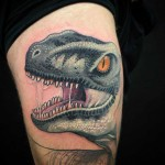 dinosaur raptor tattoo