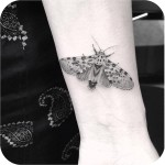 tattoo of a realistic butterfly on wrist