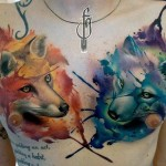 two foxes tattoo on chest