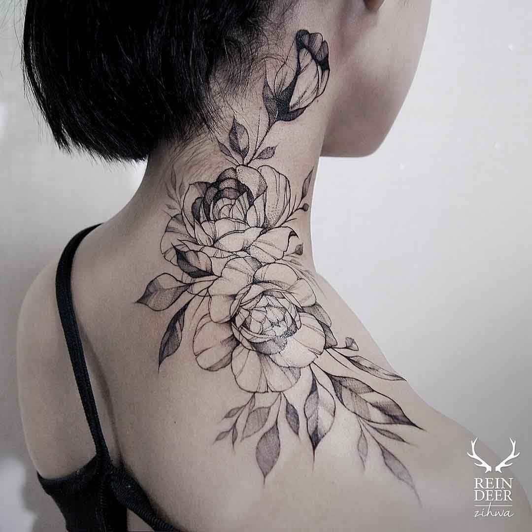 shoulder to neck tattoo of roses