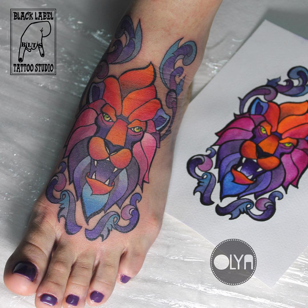 lion tattoo on foot