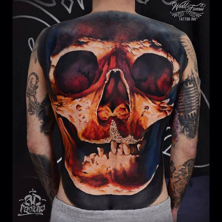 dull back tattoo of a realistic skulll