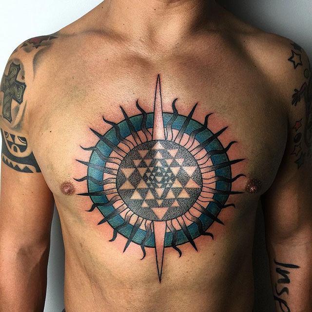 dark colors sun tattoo design on chest