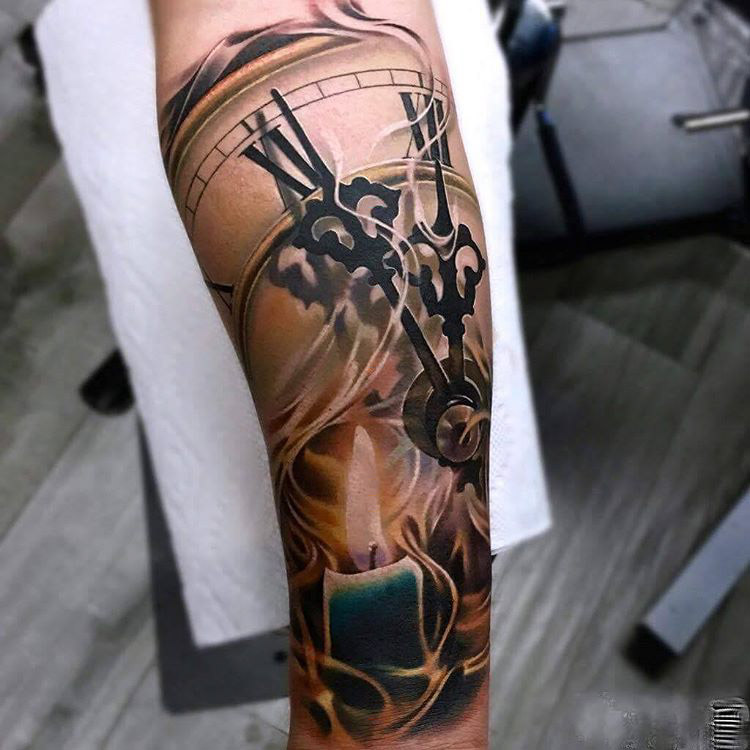tattoo of clock with burning candle