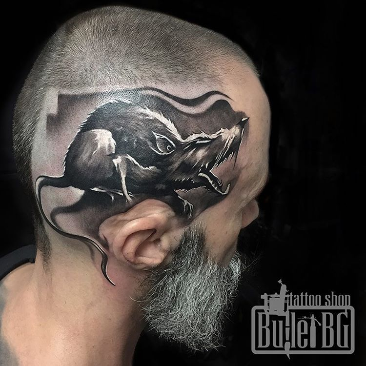 there is a rat in this head tattoo which make the tattoo idea a unique one