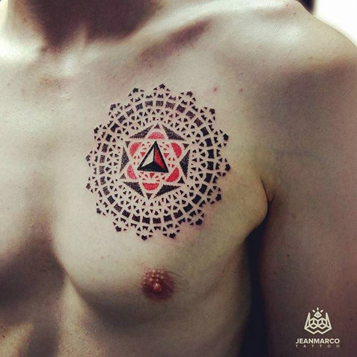 red and black dotwork mandala tattoo on chest
