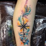 watecolor colorful background tattoo of a nautical star on arm