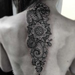 ornamental tattoo on spine
