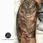 amazing realistic tiger running. Tattoo on shoulder