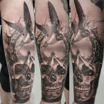 skull tattoo on the topic of the time