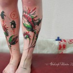 both legs decorated with flytrap flowers tattoos
