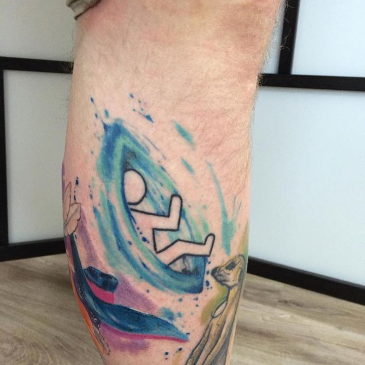 a man comming out of a blue portal. Portal Game inspired tattoo idea