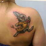 a shoulder blade tattoo of White Rabbit