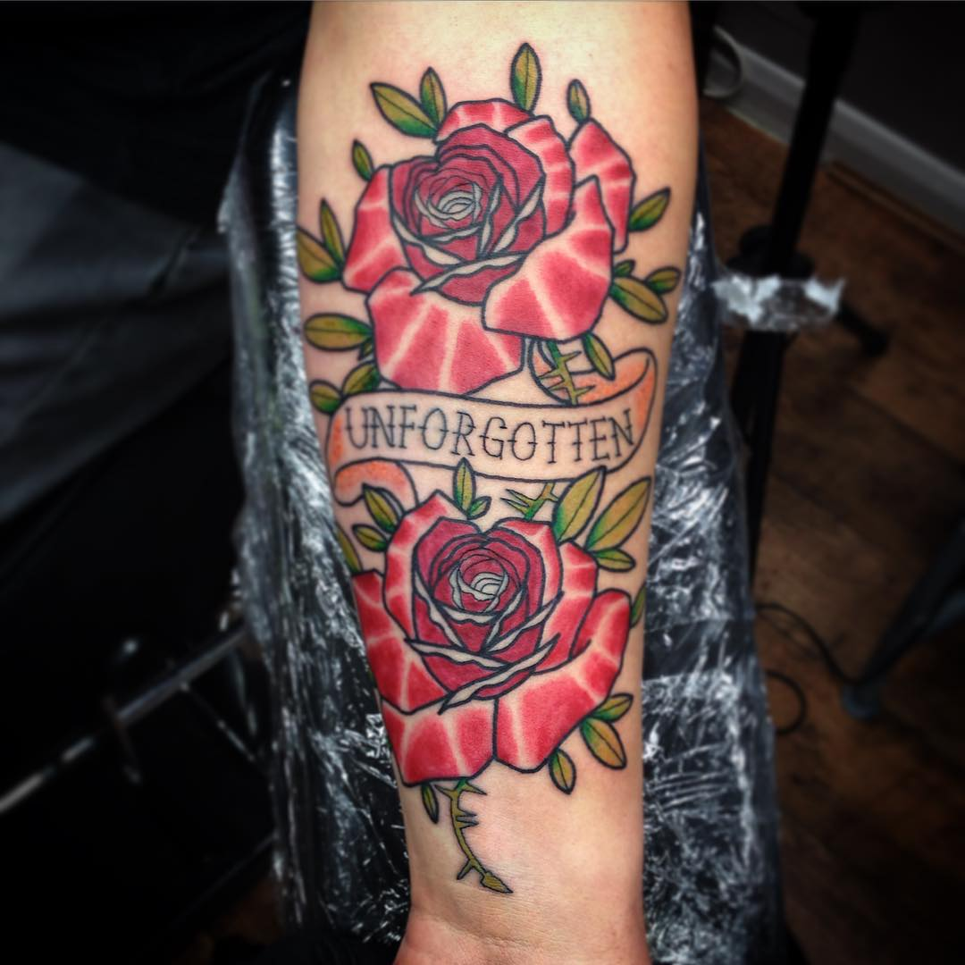 inner arm rose tattoo