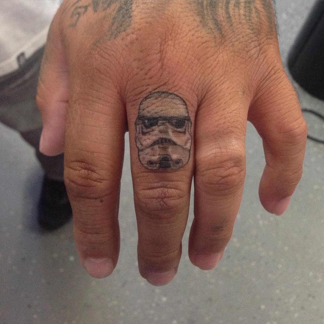 small finger stormtrooper tattoo