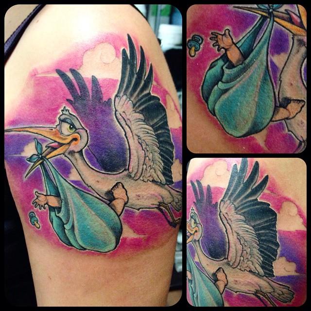 stork child tatt