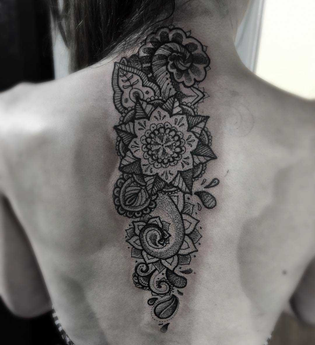 ornamental tattoo on spine
