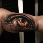 eye tattoo on bicep