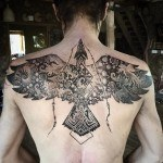 Phoenix tattoo on upper back