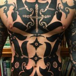 torso blackwork tattoo for men