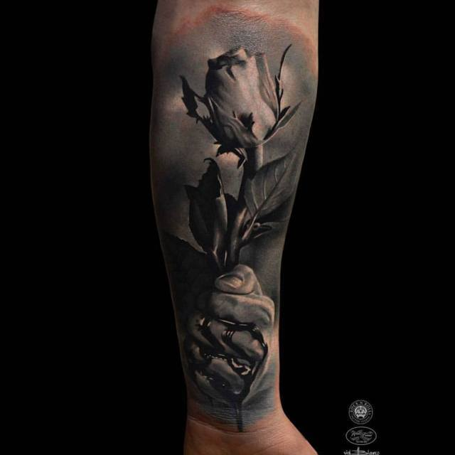 3D rose tattoo on arm