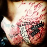 Word Trash Polka Tattoo on Chest