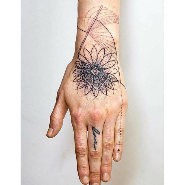 wrist and hand tattoo