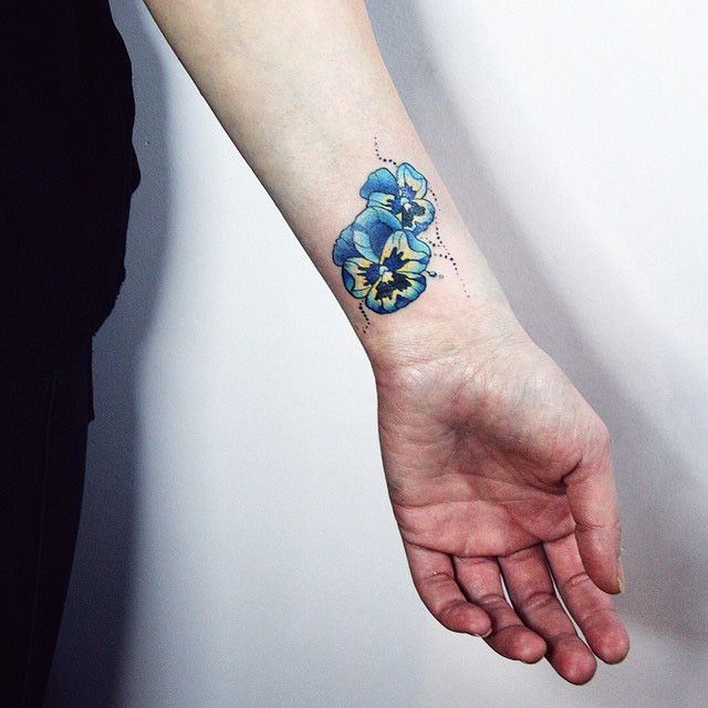 small flowers tattoo on wrist