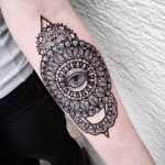 forearm mandala tattoo with eye