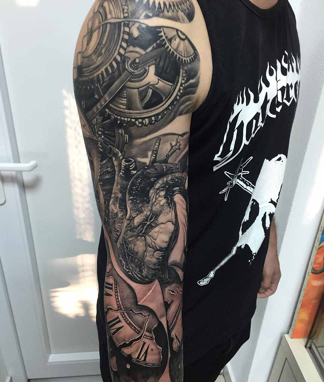 heart and cogwheels tattoo sleeve