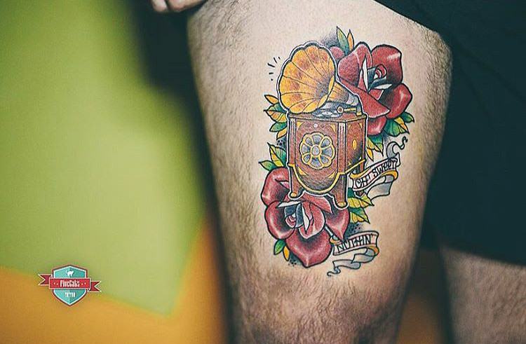 thigh neo-traditional gramophone tattoo