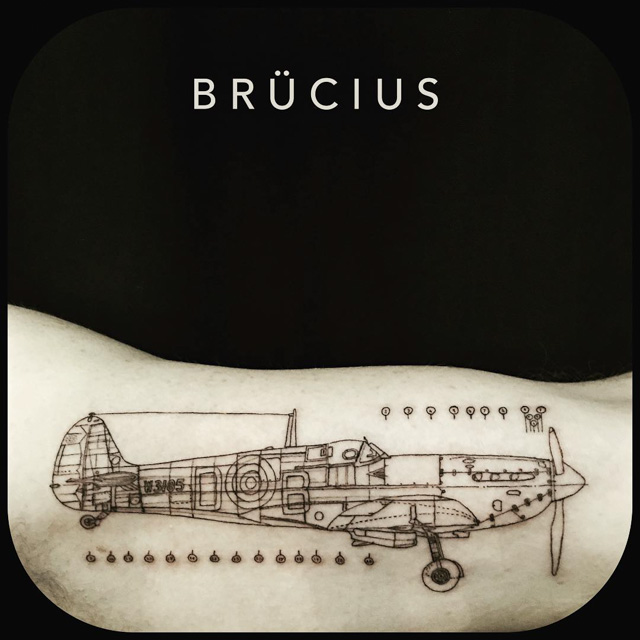 schematic plane tattoo on arm