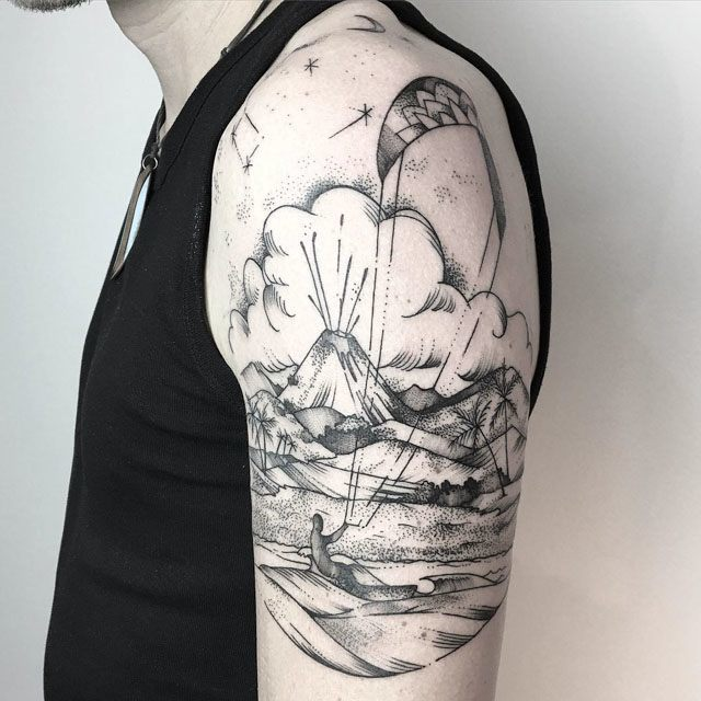 island tattoo on shoulder