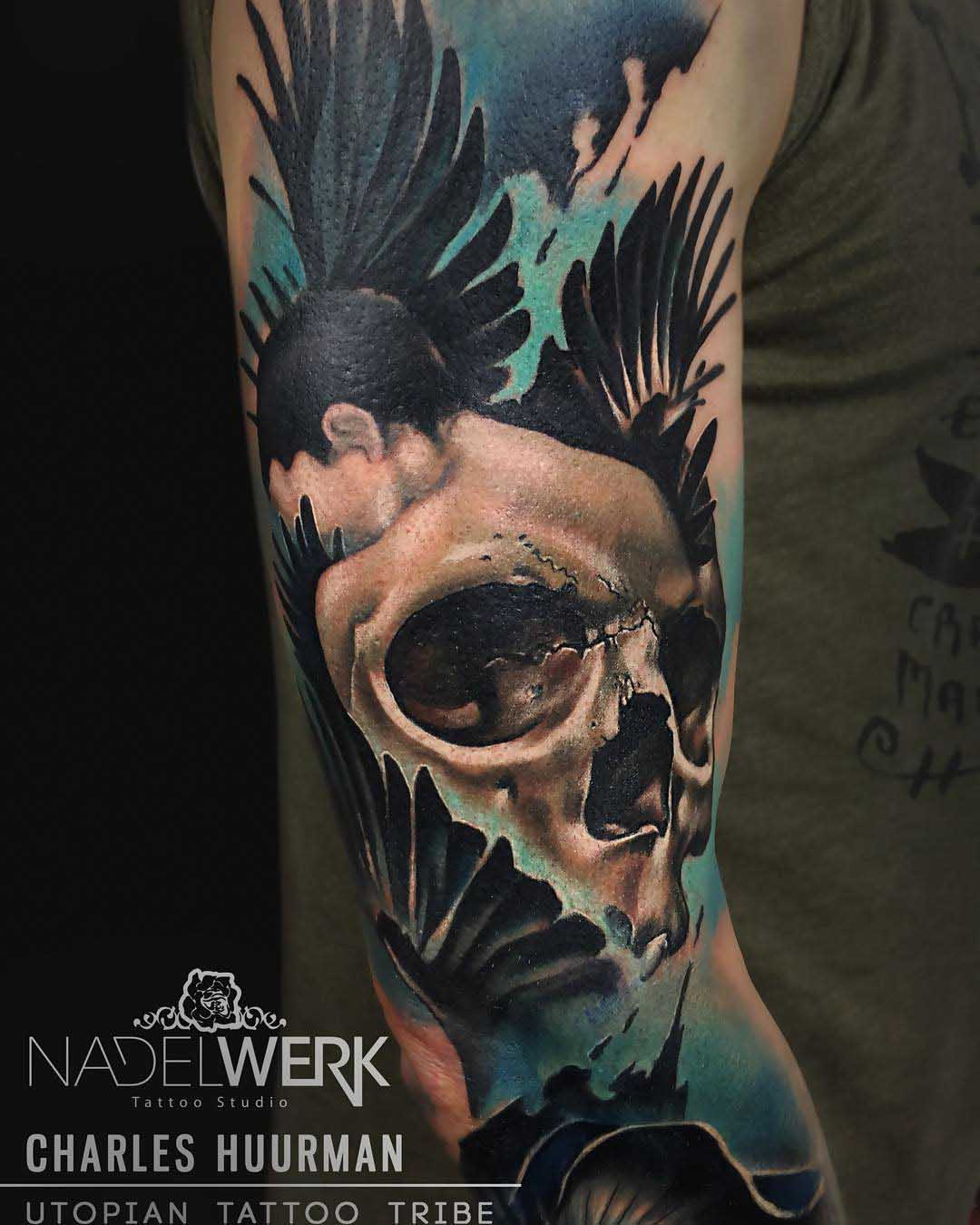 abstract skull tattoo on upper arm