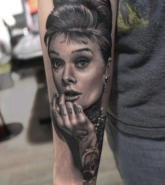 portrait tattoo on arm