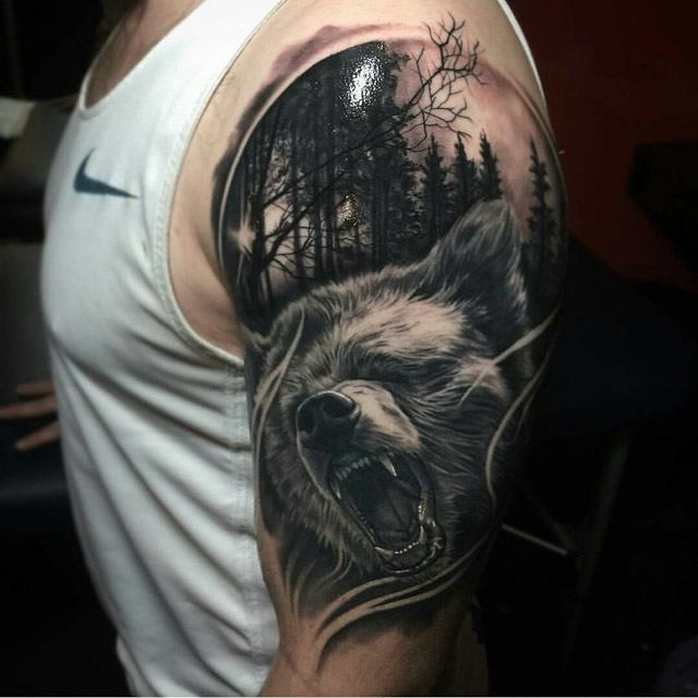 forest bear tattoo on shoulder